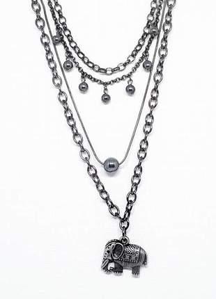 Mix de colares estilo boho chic com cristais de hematita e pingente de elefante