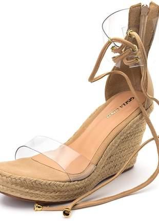 Sandália anabela salto medio tira transparente nude corda