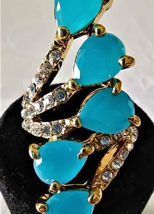 Anel dourado gotas azuis