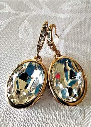 Brinco dourado pedra oval brilhante