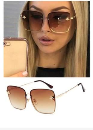 Oculos feminino grande dourado lindo !!! com case e flanela