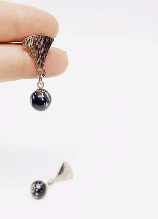 Um brinco incrível de obsidiana flocos de neve