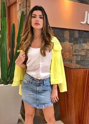 Mini saia jeans com respingos jeanseria