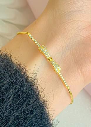 Pulseira de laço cravejada de pequenas zircônias cristais banhada a ouro 18k