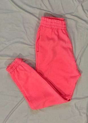 Calça jogger moletom rosa neon