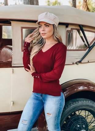 Blusa de tricô decote v com detalhes de pérolas no punho