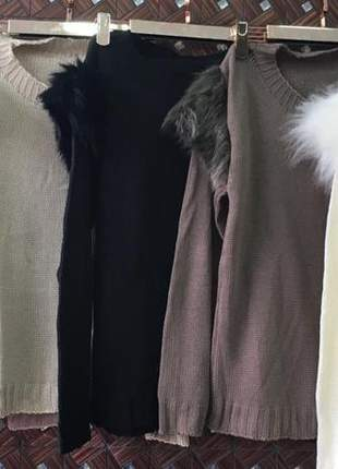 Blusa em tricô com detalhes em pelinho nos ombros