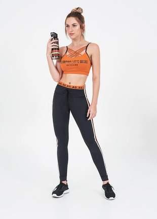 Legging alto giro atlhetic recortes e galão laranja queimado