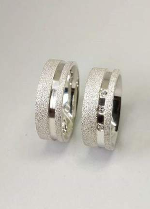 Par de aliança 6mm jateada com friso lateral liso em prata